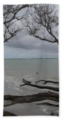 Driftwood On The Beach Beach Towel by Christiane Schulze Art And Photography