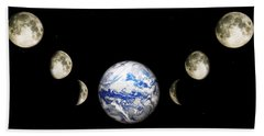 Earth And Phases Of The Moon Beach Towel by Bob Orsillo