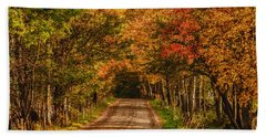 Fall Color Along A Dirt Backroad Beach Towel by Jeff Folger