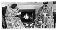 Family Huddled By Fireplace Beach Towel