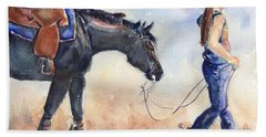 Black Horse And Cowgirl Follow Closely Beach Towel by Maria's Watercolor