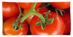 Fresh Whole Tomatos On Vine Beach Towel by David Millenheft