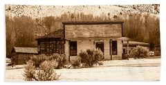 Beach Towel featuring the photograph From Saloon To Store Front And Home In Sepia by Sue Smith