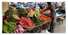 Fruit And Vegetable Seller Tends To His Cart Outside Empress Market Karachi Pakistan Beach Towel