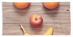 Fruit Face Beach Towel by Tom Gowanlock