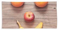 Fruit Face Beach Towel by Tom Gowanlock