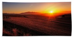 Golden Sunrise Over Farmland Beach Towel