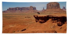Horse And Rider In Monument Valley Beach Towel