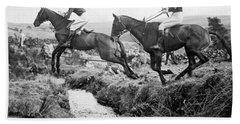 Horses Jumping A Creek Beach Towel