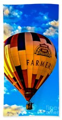 Hot Air Ballon Farmer's Insurance Beach Towel by Robert Bales