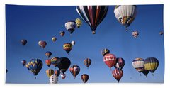Hot Air Balloons Floating In Sky Beach Sheet by Panoramic Images