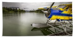 Idle Float Plane At Juneau Airport Beach Towel by Darcy Michaelchuk