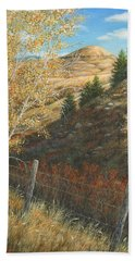 In The Shadow Of Belt Butte Beach Towel by Kim Lockman