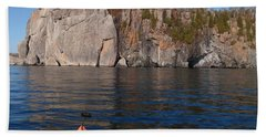 Beach Towel featuring the photograph Kayaking Beneath The Light by James Peterson
