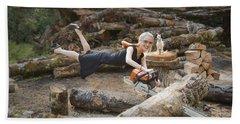 Levitating Housewife - Cutting Firewood Beach Sheet