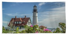 Beach Towel featuring the photograph Lighthouse And Wild Roses by Jane Luxton