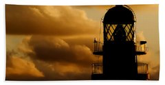 lighthouse dawn in the north coast of Menorca Beach Towel