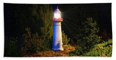 Lit-up Lighthouse Beach Sheet by Kathryn Meyer