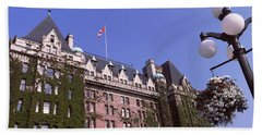 Low Angle View Of The Empress Hotel Beach Towel