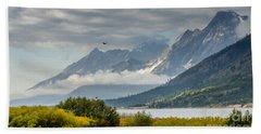 Low Clouds On The Teton Mountains Beach Sheet by Debra Martz