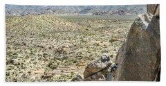 Man Climbing Rock Wall In Joshua Tree Beach Towel