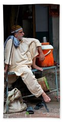 Man Sits And Relaxes In Lahore Walled City Pakistan Beach Towel