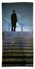 Beach Towel featuring the photograph Man With Case At Night On Stairs by Lee Avison