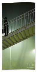 Beach Towel featuring the photograph Man With Case On Steps Nighttime by Lee Avison