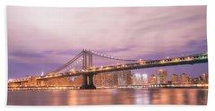 Manhattan Bridge And New York City Skyline At Night Beach Towel