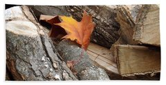 Maple Leaf In Wood Pile Beach Towel