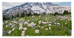 Beach Towel featuring the photograph Mount Rainier And A Meadow Of Aster by Jeff Goulden