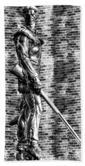 Mountaineer Statue With Black And White Brick Background Beach Sheet
