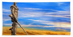 Mountaineer Statue With Blue Gold Sky Beach Towel by Dan Friend