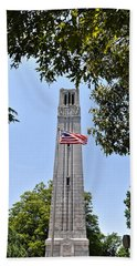 Nc State Memorial Bell Tower And Us Flag Beach Towel