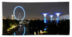 Night Shot Of Singapore Flyer Gardens By The Bay And Water Reflections Beach Towel