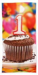 Beach Towel featuring the photograph Chocolate Cupcake With One Burning Candle by Vizual Studio