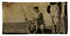 Beach Sheet featuring the photograph old sailor A vintage processed photo of a sailor sitted behind the rudder in Mediterranean sailing by Pedro Cardona