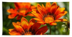 Beach Towel featuring the photograph Orange Flowers by Jane Luxton