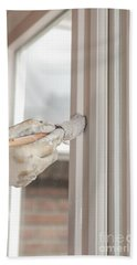 Painting A Window With White Beach Towel