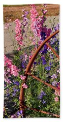 Pastel Colored Larkspur Flowers With Rusty Wagon Wheel Art Prints Beach Sheet
