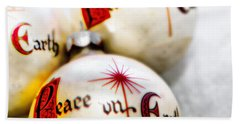 Beach Towel featuring the photograph Antique Peace On Earth Christmas Decorations by Vizual Studio