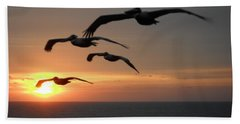 Beach Towel featuring the photograph Pelican Sun Up by Laurie Lundquist
