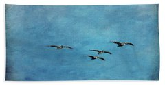 Pelicans In Flight Beach Towel
