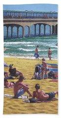 people on Bournemouth beach Boys looking Beach Towel