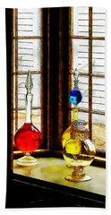 Beach Towel featuring the photograph Pharmacist - Colorful Bottles In Drug Store Window by Susan Savad