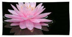 Pink Water Lily In A Dark Pond Beach Towel