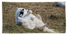 Beach Towel featuring the photograph Playful Arctic Wolves by Wolves Only