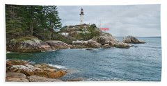 Beach Towel featuring the photograph Point Atkinson Lighthouse And Rocky Shore by Jeff Goulden