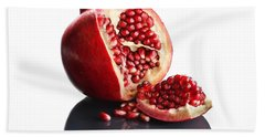 Pomegranate Opened Up On Reflective Surface Beach Towel
