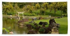 Pond Rocks Grass And Japanese Arch Singapore Beach Towel